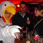 The girl dressed like a chicken (and carrying a basket of eggs) was out for her bachelorette party. She had to go up to strangers and get them to take shots with her. Suzann was up for it!