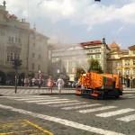 People enjoying the mist spraying trucks.